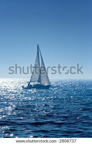 A small  boat sailing on a sunny morning