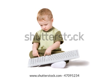 a small boy with keyboard - stock photo