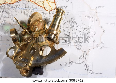 A small brass sextant on an out-of-copyright Ordnance Survey map