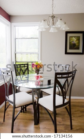 A small breakfast area in the corner of a modern kitchen #17134156