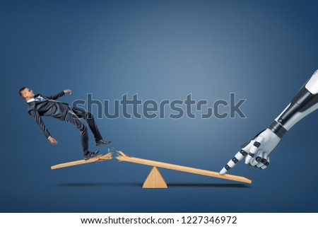 A small businessman falls from a broken plank of a see-saw when a robotic arm presses on its another side. Human vs robot. New technologies in business. Automation of business processes.