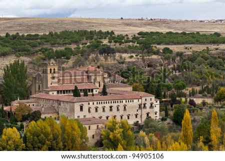 A small castle near Segovia, Spain, almost hidden by the terrain