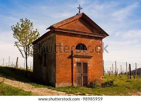 A small chapel in the italian countryside near Asti, surrounded by vineyards.