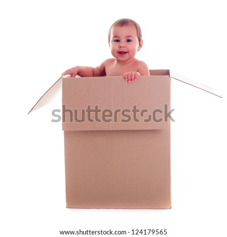 A small child (baby) crawls out of the box isolated