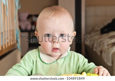 a small child looking surprised