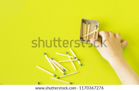 A small child plays with matches, matches matches into boxes, close-ups, fire, lucifer match, hand