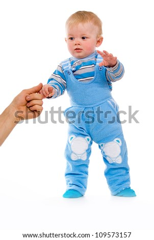 A small child takes its first steps isolated on white background