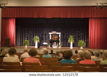 A small crowd waits for the start of a piano recital in Marion, South Carolina.