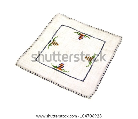A small delicate embroidered linen mat.