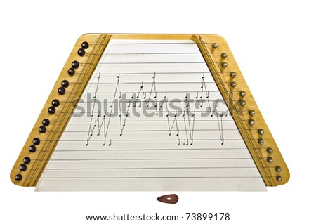A small Dulcimer with music and a pick isolated on white. - stock photo