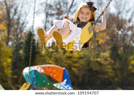 A small female child enjoying a day at the park