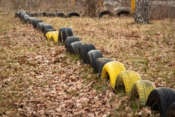 A small fence made of old tires dug into the ground.