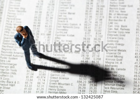 a small figure and the prices of shares in the newspaper. earn money on the stock market. gains and losses in stock trading.