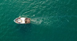 A small fishing trawler off the coast of Ayrshire, Scotland.