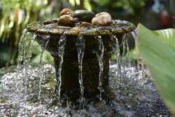 A small fountain in the garden . selective focus.