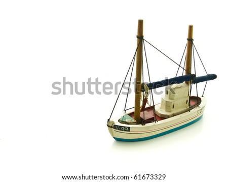 A small handcraft of wooden junk boat on white
