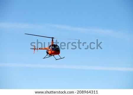 A small helicopter taking off