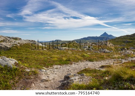 A small hiking trail on a mountain peak #795164740