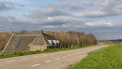 A small house behind the dike of the floodplain of the Nederrijn river, near the village Amerongen.