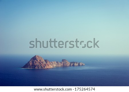 a small island in the Mediterranean in the haze