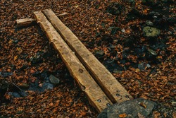 A Small Man-Made Wooden Bridge Used to Cross a Creek