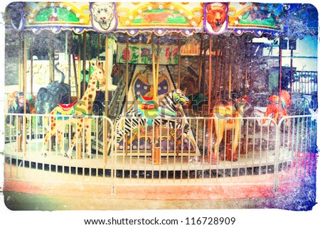 a small merry go round at a zoo - stock photo