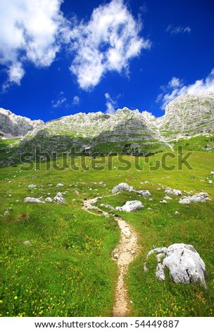 A small path leading from valley to the top of the mountain