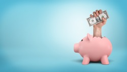 A small piggy bank on blue background with a giant male hand sticking out from its back and holds dollar bills. Grab your luck. Spend savings. Better investment.