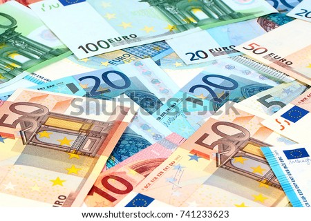 a small pile of paper euro bills as part of the trading system