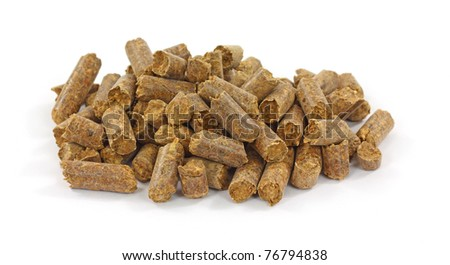A small pile of smoke flavoring pellets for barbecue on a white background.