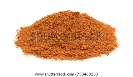 Shutterstock A small pile of taco seasoning isolated on a white background.