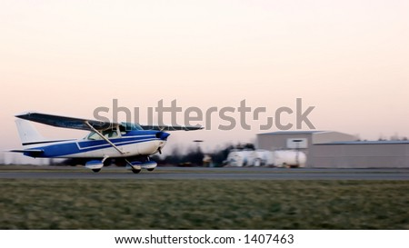 A small plane taking off from a private airport in Brockport, New York.