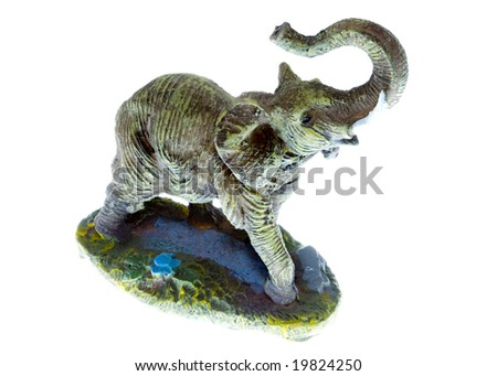 a small plastic toy elephant isolated on the white background
