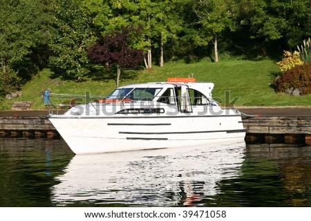 A small pleasure boat in a calm harbour