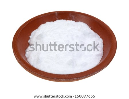 A small portion of baking soda in a red clay bowl on a white background.