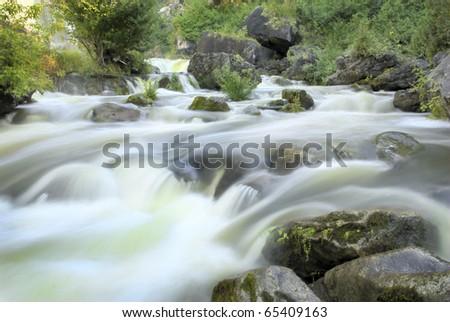 A small rapid at the base of Inglis falls on the Niagara Escarpment near Owen Sound Ontario Canada