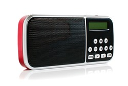 A small red metallic pocket digital radio on a white background