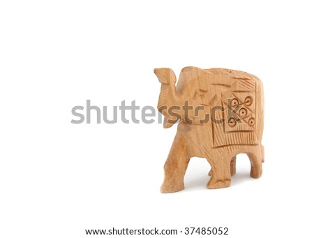 A small roughly carved wooden elephant isolated on white