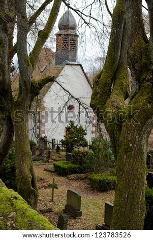 A small rural church with cemetary at Steinegg in Germany.