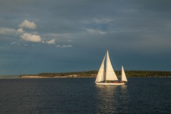 A small Sailboat on the water at sunset near Port Townsend, Washington, USA
