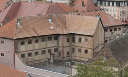 A small scale prison for men or male prisoners in Belfort, France,  located in a historical building in the old city. Its architecture matches the surroundings or the neighbourhood.