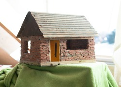 A small selfmade brick house. Every little cly brick of this house was made and fired individually giving it a very rusty look.