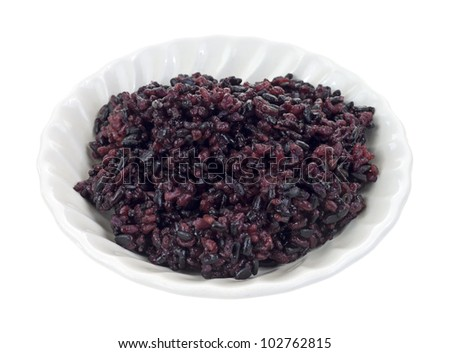 A small serving of black pearl rice in a bowl on a white background.