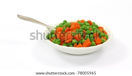 A small serving of peas and carrots with spoon in a white dish.