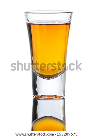 A small shot glass of delicious single malt whiskey with reflection . Isolated on white #153289673