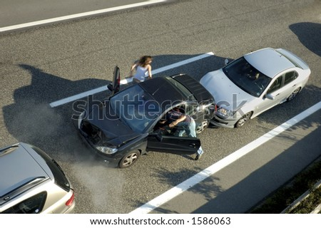 A small shunt on the freeway (motorway, autoroute, autobahn) a few seconds after it happened. Smoke is coming from under the bonnet of the black car. Motion blur on the passenger fleeing in panic.