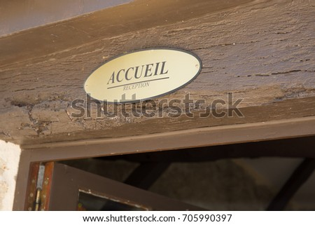 A small sign in gilded metal with inscribed reception in french for a country typical hotel #705990397