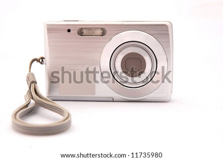 A small silver digital camera isolated on white background