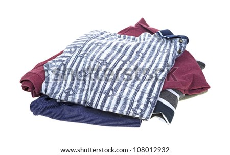 A small stack of freshly washed and dried worn shirts on a white background.