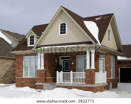 A small suburban house in winter.